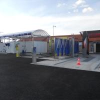 Centre de lavage 3 pistes dont 2 avec couverture inox et portique starbrosse et Powerjet