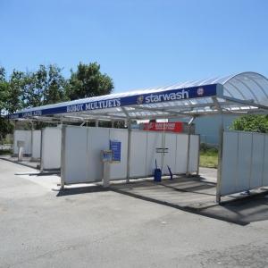 Transformation d'un centre de lavage 4 pistes en 3 pistes couvertes et powerjet couvert
